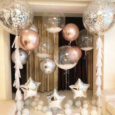 Оформление фотозоны воздушными шарами со звёздами и баблсами