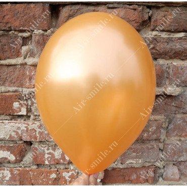 Шарик оранжевого цвета оттенка металлик