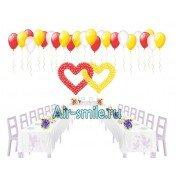 Переплетенные сердца из шариков на свадьбу